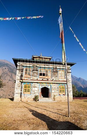 Buddhist monastery or gompa in Kharikhola village with prayer flafs near Lukla way from Jiri Bazar to Everest area Khumbu valley Solukhumbu Nepal