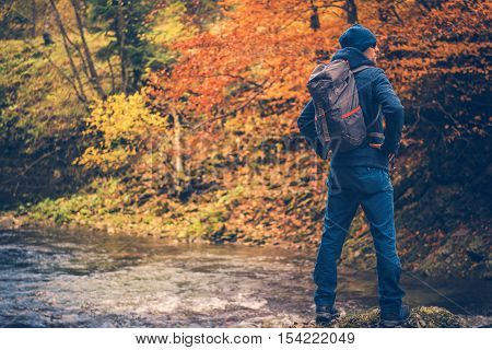Autumn Time Colorful Forest Hike. Autumn Foliage Hiking. Caucasian Men in His 30s Enjoying the View.