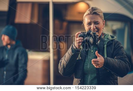 Digital Photography Hobby. Woman in Her 30s with Semi Professional Digital Camera Learning and Enjoying Photography.