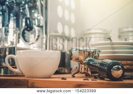 Espresso Coffee Making. Shiny Metallic Coffee Machine in the kitchen.