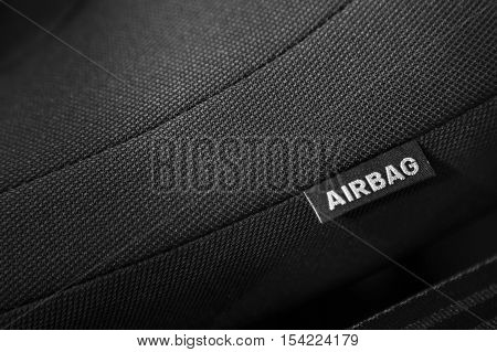 Detail of a car interior, airbag sign