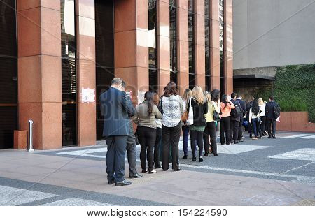 Sao Paulo Brazil - October 5: People standing in a line to enter office building on Avenida Paulista in the morning on October 5 2014 in Sao Paulo Brazil.