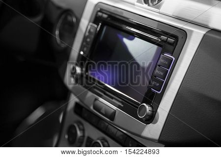 Car interior; Control buttons on dash and steering wheel- detail