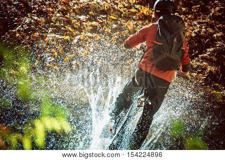 High Speed Bike Ride Mountain River Crossing with Huge Water Splash. Extreme Mountain Biking