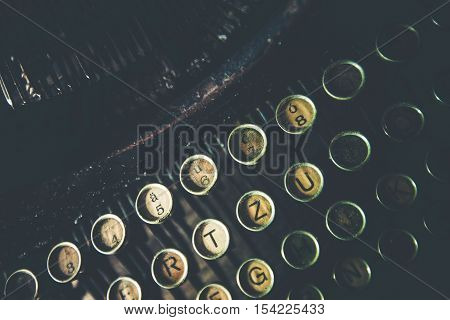 Old Rusty Typewriter Closeup Photo. Vintage Typewriting.