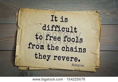 Top 50 quotes by Voltaire - French, writer, historian, philosopher. It is difficult to free fools from the chains they revere.