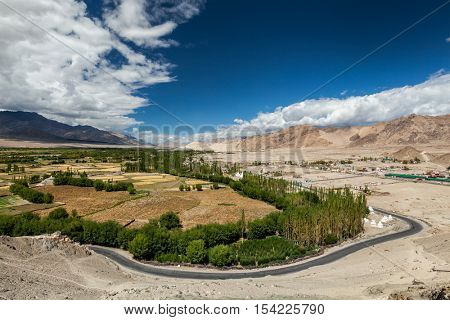 View of Indus valley with road from Thiksey gompa. Ladakh, India