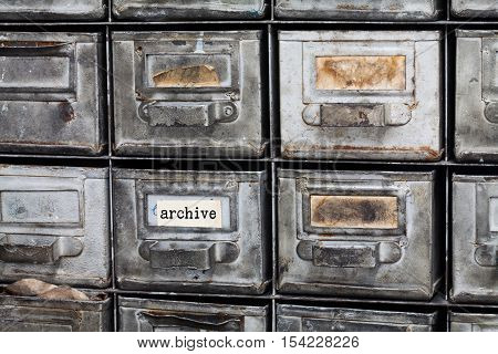 Archive vintage box. Closed metallic storage, filing cabinet interior. aged silver metal boxes with index cards. library service information security