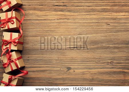 Present Gift Box on Wood Background Holiday Cardboard Boxes over Grunge Wooden Texture