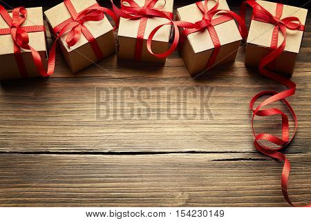 Gift Boxes on Wood Background Holiday Cardboard Presents on Brown Wooden Decoration Red Ribbon