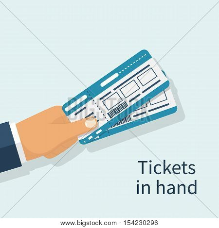 Man Holds Tickets In Hand.