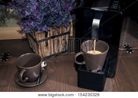 Coffee machine pouring in cup. brewing some coffee