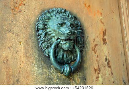 Detail Photography Of Old Metal Door Knocker Lion Head