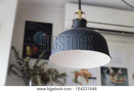 Retro light of black hanging lamp stock photo