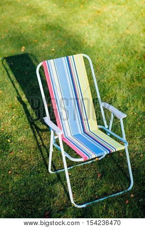 garden chair on green lawn background