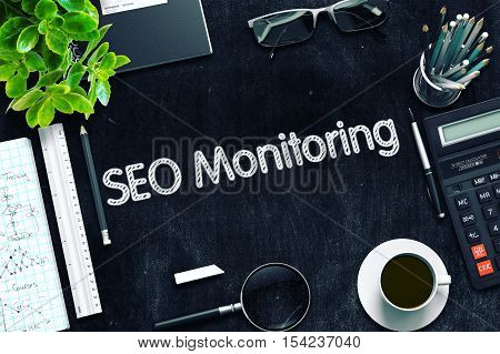 SEO Monitoring on Black Chalkboard. 3d Rendering. Toned Illustration.
