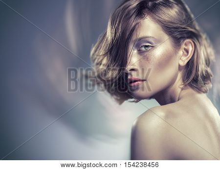 Portrait of a beautiful sexy woman with natural makeup. Glamour picture