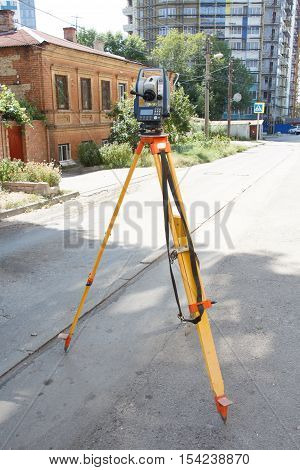 Tachymeter on tripod a total station or TST (total station theodolite) is an electronic/optical instrument used in modern surveying and building construction for the rapid measurement of distances.