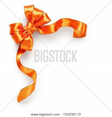 Orange ribbon bow isolated on white background clipping path included