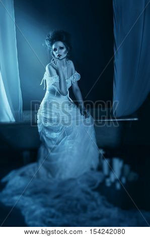 Full Body Beautiful Girl Ghost, Witch, Bride Sitting On A Vintag