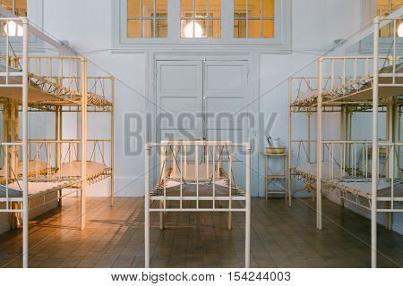 Antique Collective Hospital Room With Bunks, A Pitcher And Basin