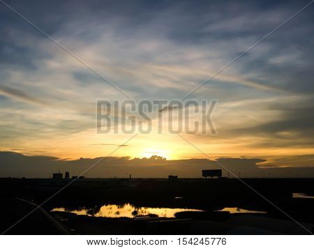 Silhouette Of Sunset From Hometown In Thailand. Downtown Landscape.