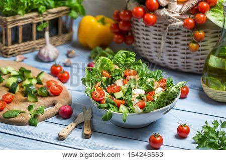 Healthy fresh spring salad on wooden table
