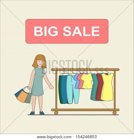 Big sale concept. Woman does shopping in the shop. Clothes checkout.