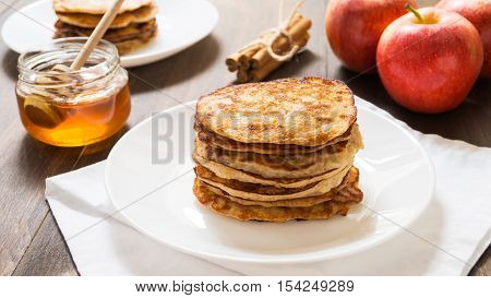 Apple cinnamon whole wheat pancakes on a white plate selective focus horizontal