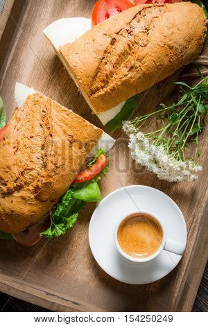 Nice Breakfast With Coffee, Sandwich And Flowers