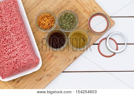 Freshly Minced Raw Beef With Jars Of Seasoning