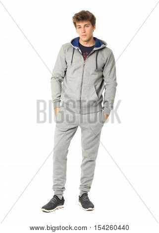 Young Male In The Gray Sportswear Isolated On White