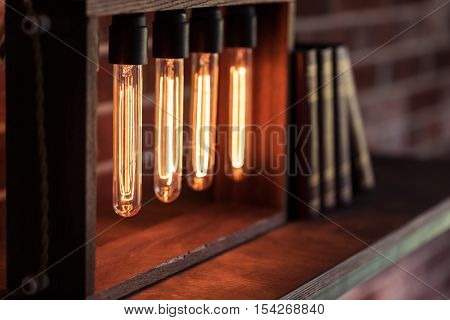 Modern style. Close up of a decoration for a masculine study room standing on the wooden shelf