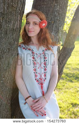 portrait of a happy young girl of European appearance with warm spring sunny day