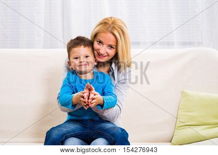 Mother and son are spending time together at home.