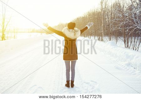 Joyful Woman Enjoying The Winter Snow .