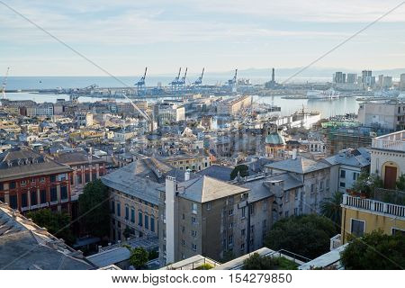 GENOA, ITALY - AUG 6, 2016: View at Port of Genoa with cranes and old lighthouse. Port of Genoa is the major Italian port on the Mediterranean Sea.