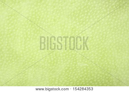 yellow leatherette texture background. Horizontal close up