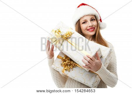 Christmas Santa hat isolated. Woman hold christmas gift. Smiling happy girl on white background