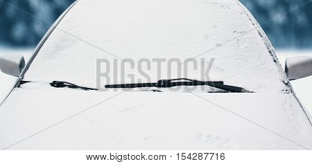 Frozen Car Covered Snow In Winter Day, View Front Window Windshield And Hood On Snowy Background