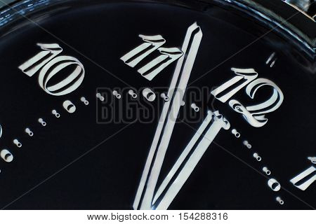 Eve of new year.Clock face in darkness taken closeup.Digitally altered image.