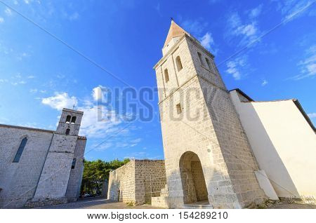 The pyramidal tower of the Church of our Lady of Health a romanesque cathedral formerly named St Michael the archangel basilica at the Square of the The Glagolitic housed monasteries on Krk island in Croatia.