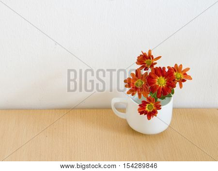 Red flowers on table - condolence card