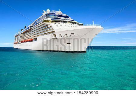 Luxury cruise ship sailing to port on sunny day