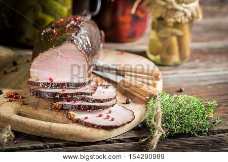 Fresh piece of smoked ham on old wooden table