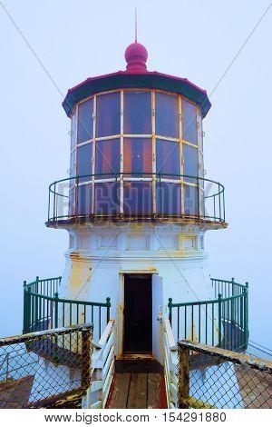 Pt Reyes Light Station which is a historical landmark taken in the fog at Pt Reyes, CA