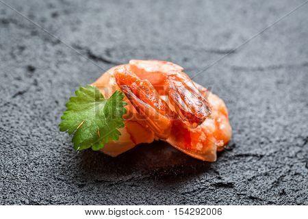 Closeup of fresh seafood on a black rock