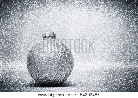 Christmas glass balls decoration on silver glitter background. Christmas card template