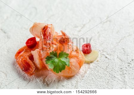Fried Shrimp Served On A White Stone