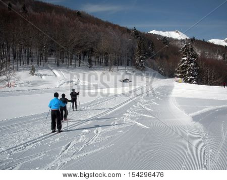 cross-country skiers at the Somport Station (France)